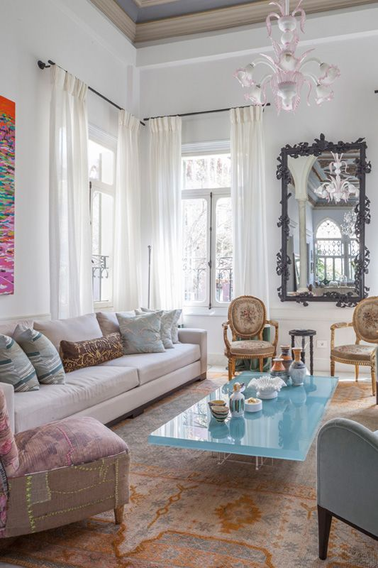 eclectic mix of furniture, simple white curtains