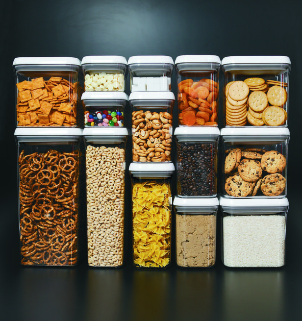 """POP Containers, our latest OXO addiction, let you store everything from crackers to oats to pasta in plain sight. Designed for modular stacking, the square and rectangular shapes make storage a snap. Speaking of """"snap,"""" sealing them couldn't be easier — just push the button for an airtight seal. To open, push the button again. It pops up and becomes the handle. Genius."""
