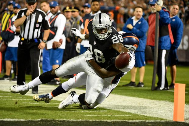 Broncos vs. Raiders:   November 6, 2016  -  30-20, Raiders  -    Oakland Raiders running back Latavius Murray tries to score a touchdown but is stopped at the 1-yard line against the Denver Broncos at the Oakland-Alameda County Coliseum on Nov. 6, 2016, in Oakland, Calif.