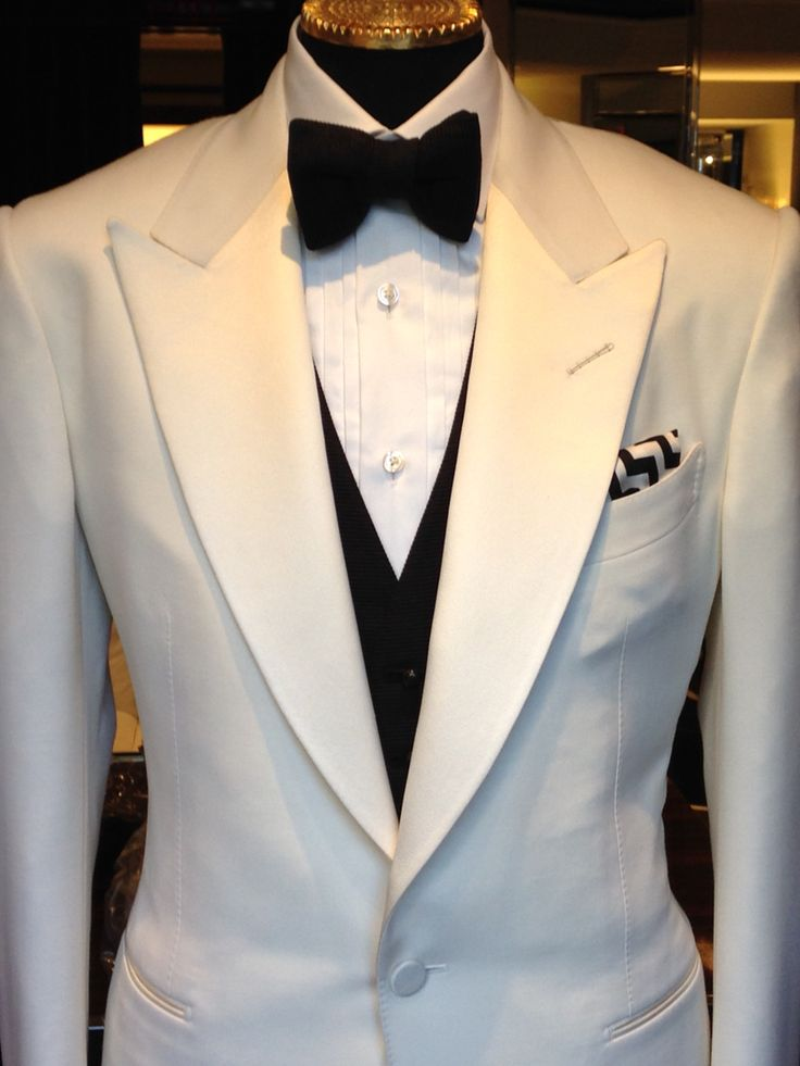 White dinner jacket from Tom Ford. Not crazy about the vest or the pocket square, but the jacket is exquisite.