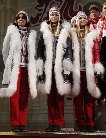 I want every single one of the long coats - Russian athletes pose for the press during the presentation of the uniforms for the Russian national Olympic team for the upcoming 2014 Winter games