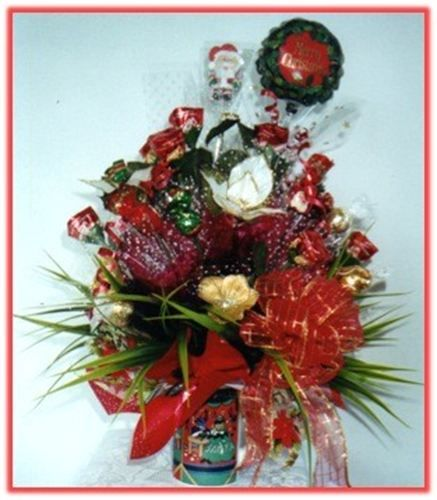 """""""MERRY CHRISTMAS"""" Candy Bouquet : An assortment of fine chocolates  combined with silk flowers, greenery and hand made silk bow, settled in a ceramic cup.    Prices start at AUD $29.95   Price as shown AUD $45.95   Code: CB 036"""