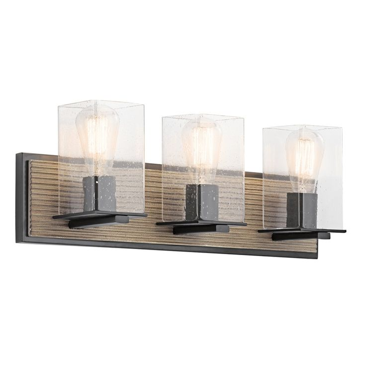 """This 3 light bath light from the lodge-inspired Millwright collection was designed with a versatile look in mind. The wood stained finish on the back plate makes this piece a perfect option for a rustic bathroom update. Seeded glass and matte black accents complement the Distressed Antique Grey wood finish.    Weight:6.60 LBS  Safety Rated:Damp  HCWO:5.25""""  Base Backplate:22.00 X 5.00  Max Wattage/Range:100W  Collection:Millwright Collection  Width:22.00""""  Height:7.75""""  Lamp…"""