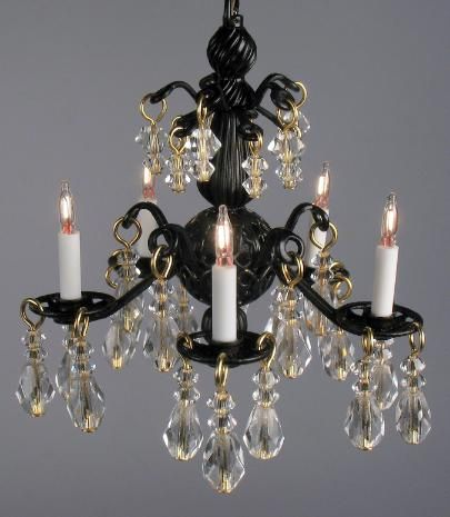 Jacqueline:  The Jacqueline chandelier in a rich black color with clear Swarovski crystals and Austrian glass creates an elegant look to a room setting.  It has 5 candlelights.  2 inches in length 2 inches in diameter