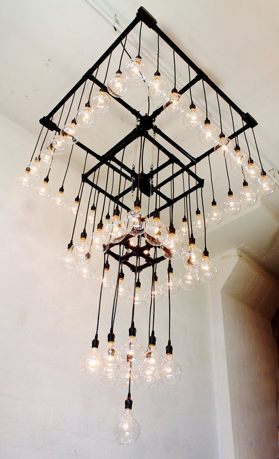 Pipe repurposed into light fixture for West Palm Beach store opening on Clematis