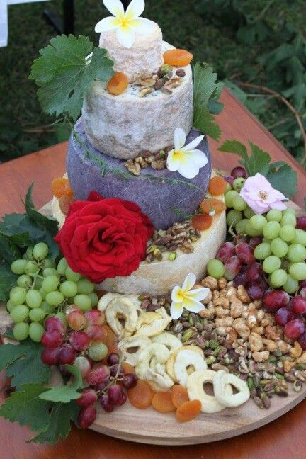 "Cheese Tower Our wedding "" cake "" One of my wishes for our wedding was to have a cake of cheese! I researched various cheeses for days, searched how the cheeses should "" marry up "" and worked with some wonderful women that obtained the cheese for me. With my sister's artistic skills, this beautiful cheese tower was born! I couldn't have been happier with how it turned out, and how all of the cheeses tasted!"