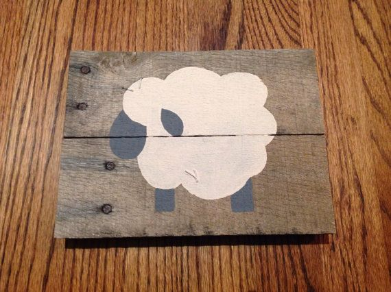 Lamb nursery pallet art. These little lambs are soo adorable! My brother-in-law is expecting a girl soon and she will have a lamb nursery. I wanted to make something cute for her room. I love how these three lambs came out. Their simplicity will look so great in her room. The