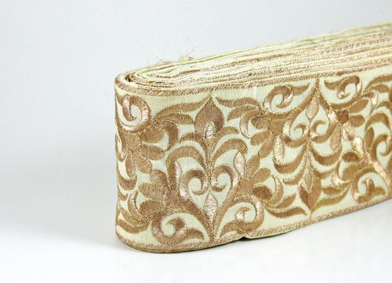 3in gold-on-ivory embroidered fabric trim. Another large design, this one's also likely to overwhelm. Good for dress or cloak hems, or the opaque background might make it suitable for cuffs.