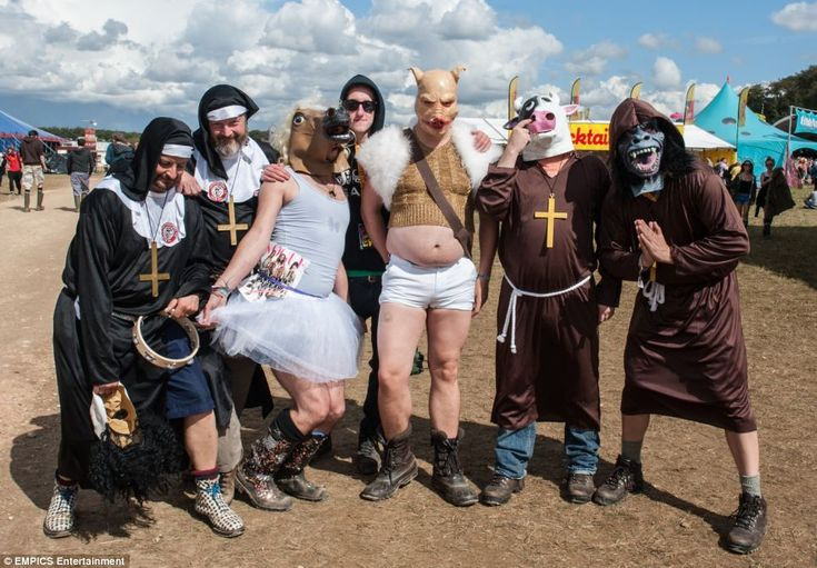 Festival-goers dressed in outlandish fancy dress make the most of the sunshine at Leeds Fe...