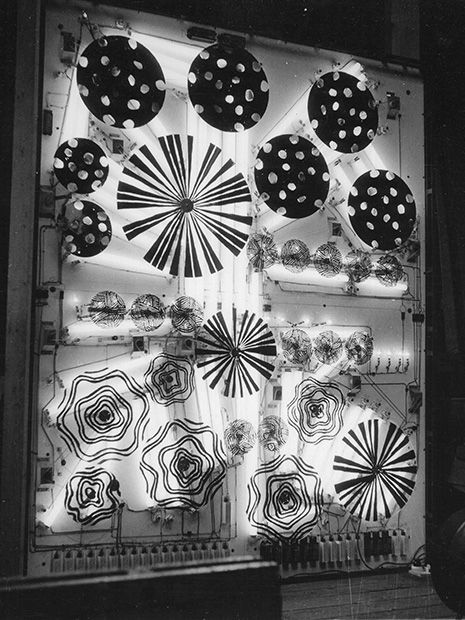 """Frank Malina creating """"Cosmos"""". (1965) lumino-kinetic work. The lights switched on, and immediately the many small electrical motors inside began to turn the painted rotors. For such a giant mechanical piece, it was surprisingly quiet. (Cosmos as seen from inside, Photo by Patrick McCray)"""