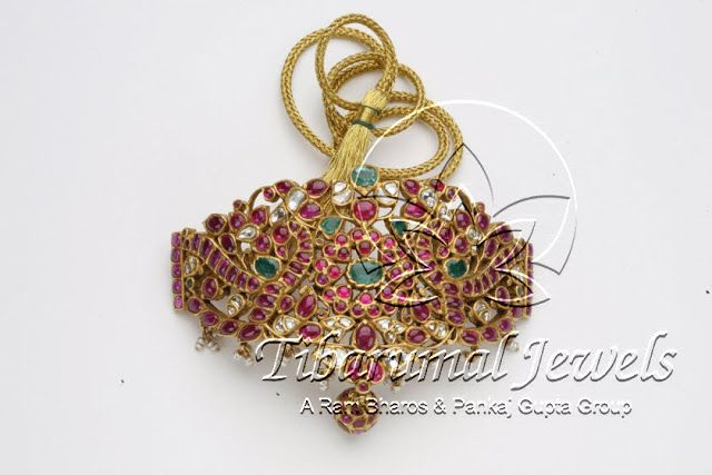 Indian Jewellery and Clothing: Peacock design baaju bandh/ara vanki/ Armlet studded with rubies and emeralds from Tibarumal Jewels..