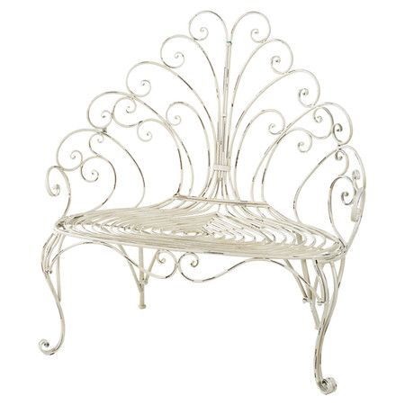 Featuring a scrolling back and cabriole front legs, this eye-catching metal garden bench is highlighted by a distressed cream finish for warmly weathered app...
