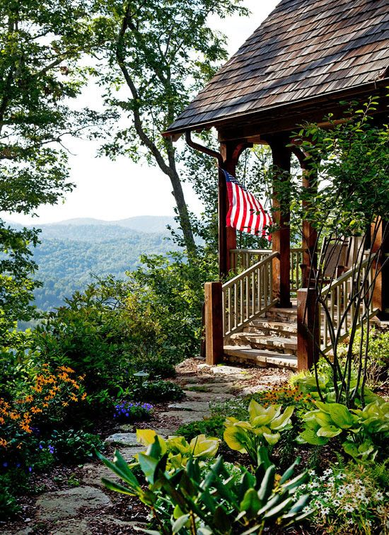 Lovely scene from the porch of this North Carolina home in the Blue Ridge Mountains - Traditional Home®  Photo: Emily Followill
