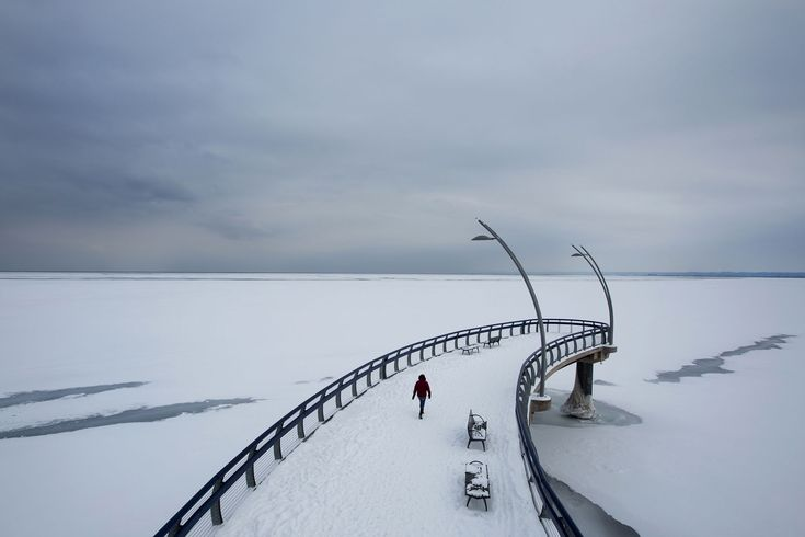Lake Ontario is frozen over as far as the eye can see from the pier at Spencer Smith Park in Burlington, Ontario on Feb. 22, 2015.