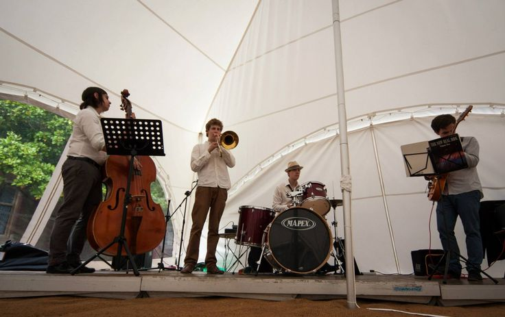 Live band in Capri marquee. Perfect venue for rustic and festival themed weddings and parties. www.lexmarqueehire.co.uk #marquee #wedding