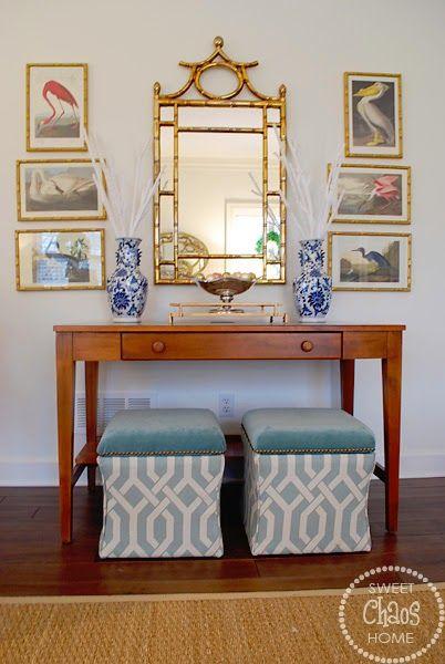 vignette console bamboo mirror audubon prints upholstered ottomans under console