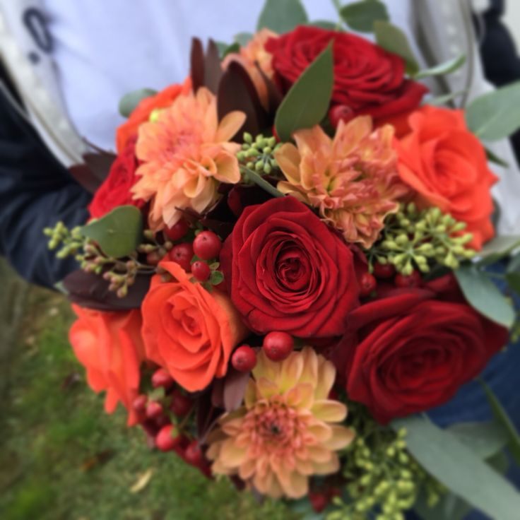 Orange dhalia, orange and red roses Wedding bouquet Made by Fiori&co
