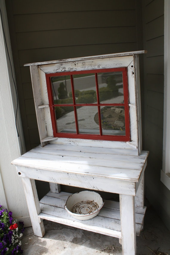 Love the red window in this potting bench!