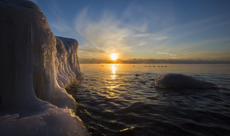 The sun reflects off ice formations on the Lake Ontario shoreline at Len Ford Park, Etobicoke as temperatures drop, January 23, 2014.