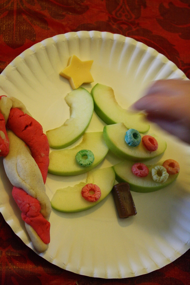 Apple slice Christmas tree snack with cheese for the star and a tootsie roll for the trunk.  Then the kids decorated their tree with fruit loops.  Very fun, mostly nutritious Christmas snack!
