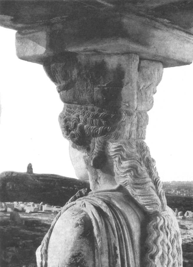 A view behind a Caryatid of the Erechtheion. (Athens, Greece)