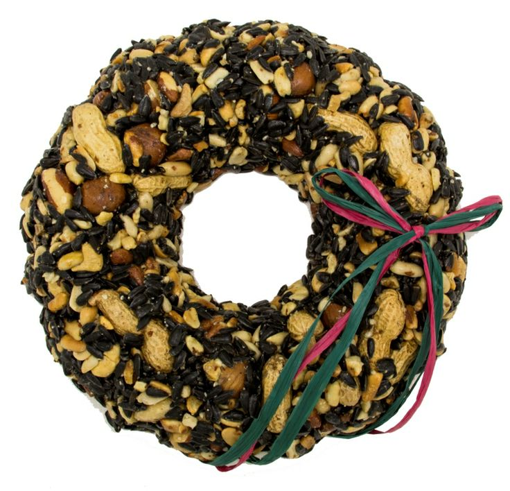 """WRTHN Christmas Nut Wreath The addition of walnuts and Filberts makes this wreath even more attractive to woodpeckers as well as the other birds like chickadees, jays, finches, nuthatches, doves, sparrows, flickers, cardinals, grosbeaks, etc. Approximately 9"""" Diameter x 2""""H. Approximately 610g"""