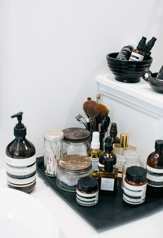 assorted beauty products on black tray. / sfgirlbybay