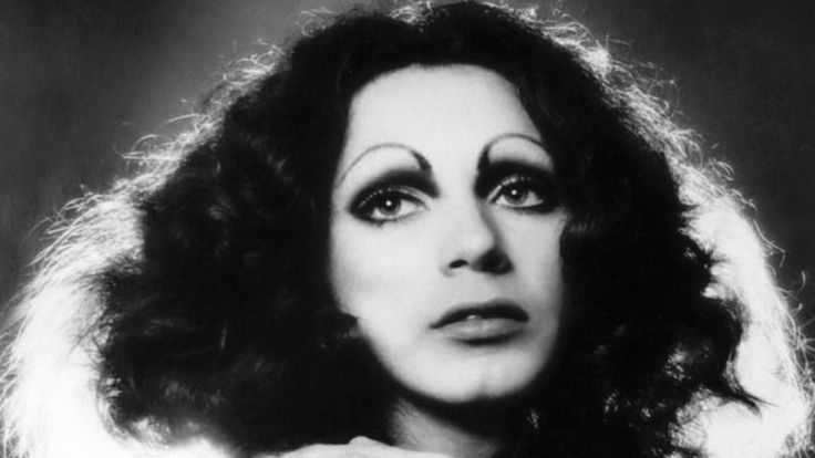 """""""Holly [Woodlawn] gave visibility long before it was comfortable to do so—and gave thousands of people both hope and pleasure."""""""