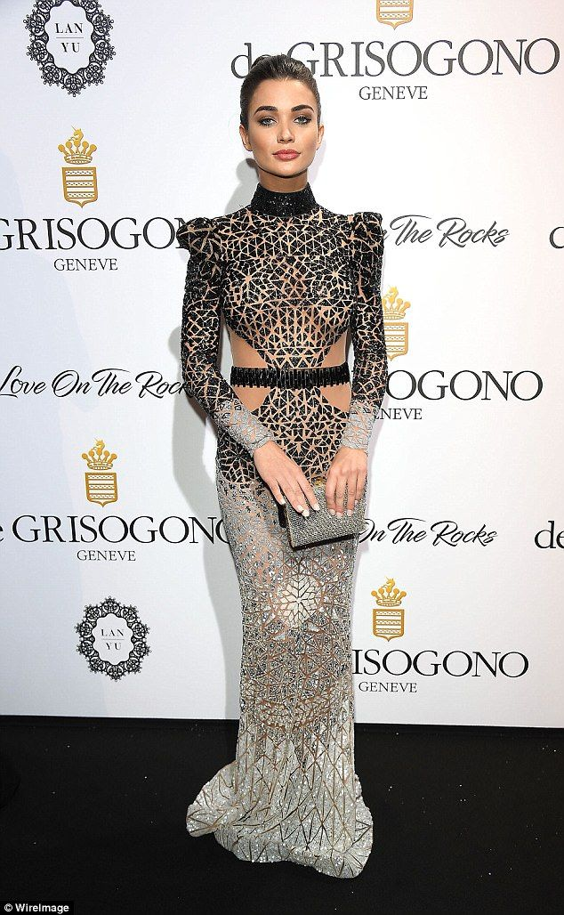 Silver siren:Amy Jackson looked incredible as she posed up a storm on the red carpet