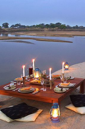 Romantic outdoor dining, Luangwa River Camp, Zambia