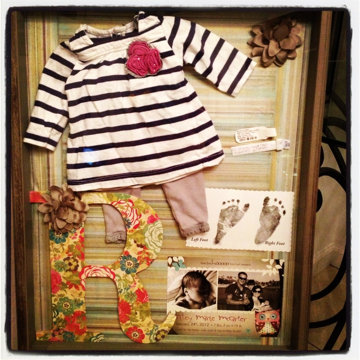 Riley's shadow box... Newborn homecoming outfit, hospital bracelets, footprints, and birth announcement <3