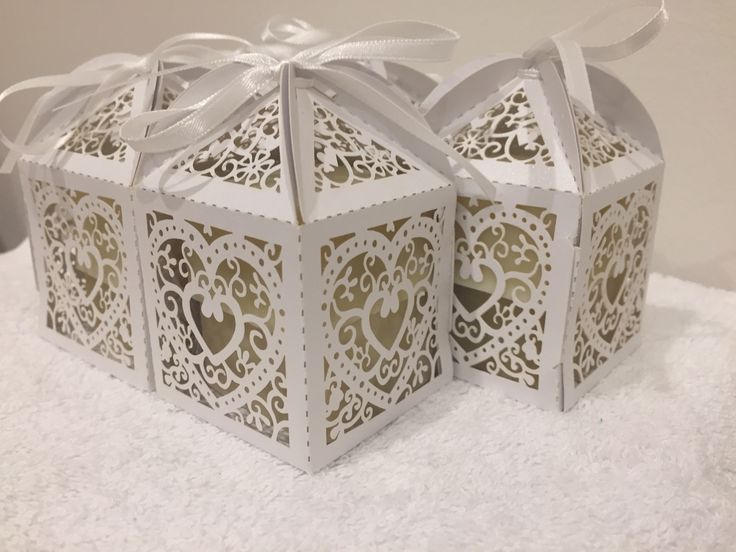 Two guest soaps fit snugly in the decorative laser cut boxes. They look like wedding thank you's.