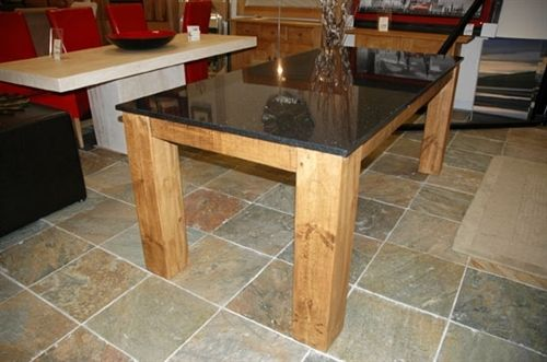 Ask granite warehouse about scrap granite to be fabricated for a table top???