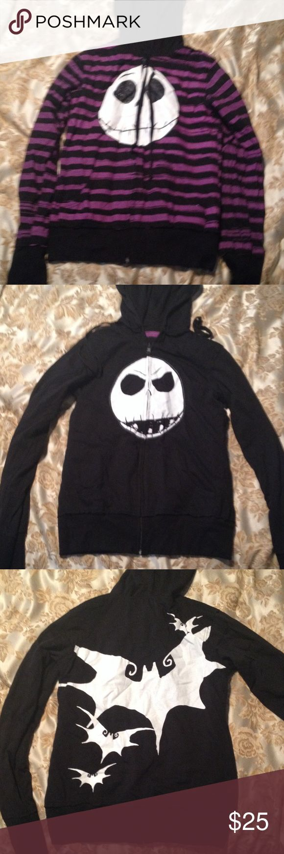 The Nightmare Before Christmas Hoodie From Hot Topic's collection is this reversible front zip hoodie with front pockets on both sides Jack Skellington smiling with black and purple stripes.  On the other side is black with everybody's favorite pumpkin king grimacing  bats fly off on the back of the black side.  Size L.  60% cotton,40% polyester.  Care instructions on label inside black/purple side front pocket.  Switch it up with your mood! All hail the Pumpkin King  Tops Sweatshirts…