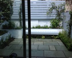 The small garden in neutral tones is a continuation of the chilled out living space