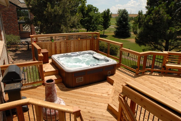 Redwood deck with built in seating and hot tub unique for Hot tub deck designs plans