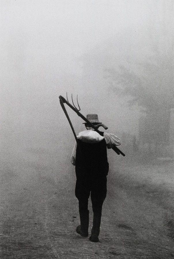 Péter Korniss. Dawn with a scythe  Szék (Sic, Romania). 1974