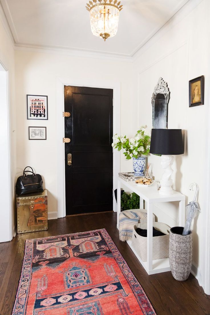 yana's entryway - collected antiques + modern parsons style console, black door: