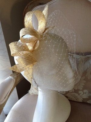 Gold loop sinamay fascinator with netting in a silver headband. Gorgeous on and affordable! by CanteringDesigns on Etsy