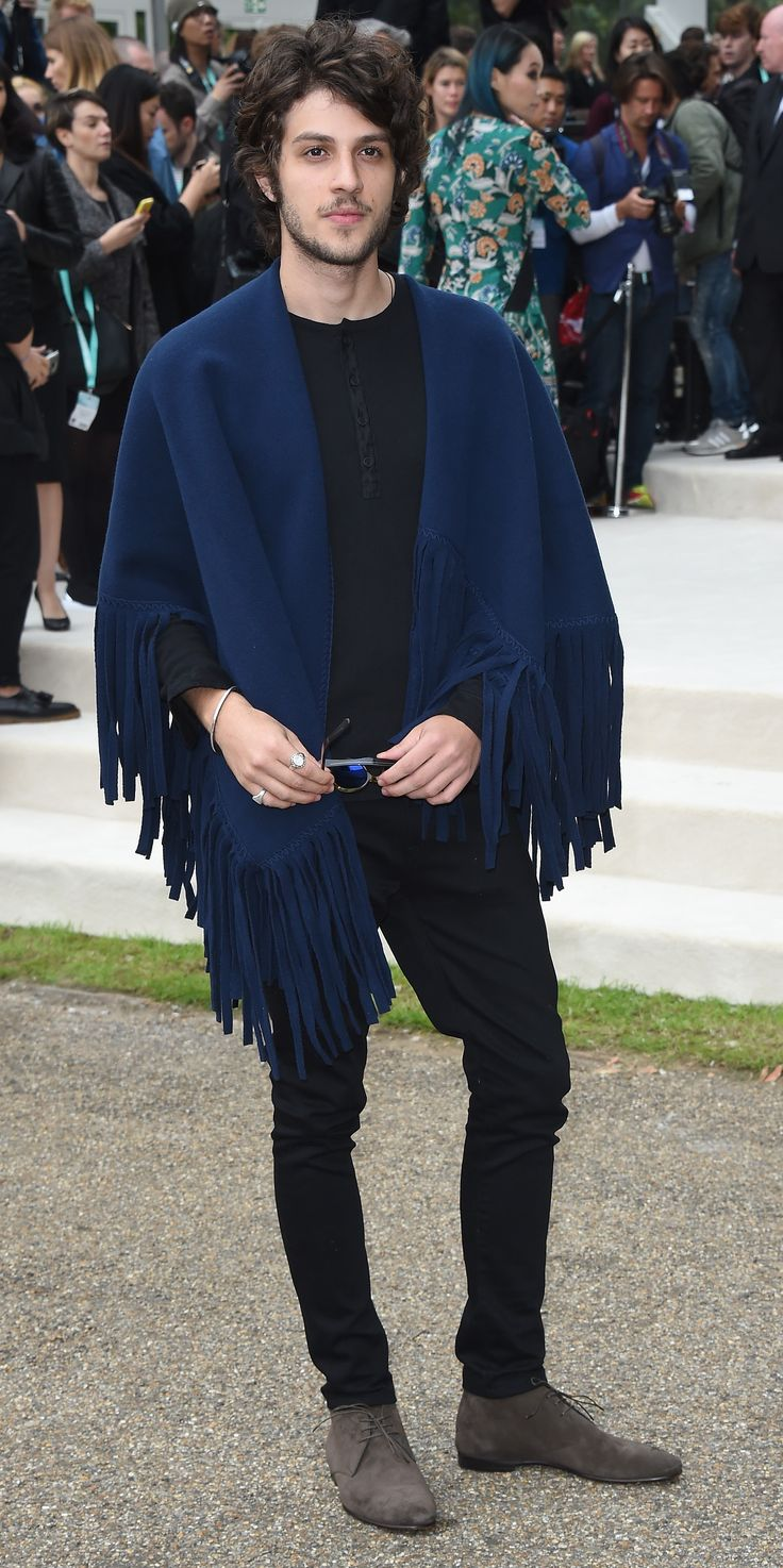 Chay Suede wearing a fringed A/W15 poncho at the Burberry show