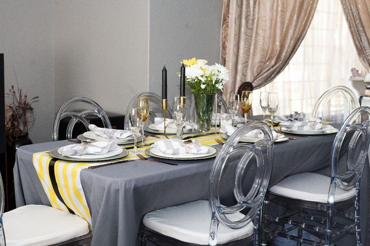 Grey, Yellow and white Bumble Bee Baby Shower. Formal Sit down setup The Chic Connective is a luxury event Planner based in johannesburg. We create breathtaking, warming and inviting celebration spaces, so you can connect with those closest to you, and celebrate life's milestone. Contact us on thechicconnective@gmail.com
