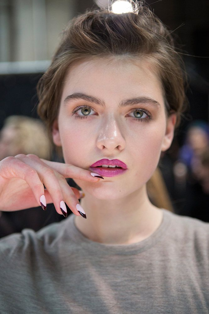 Francesca Liberatore tweaked the French manicure by opting for a matte pale pink base with an opaque finish. Oxblood tips and a long, rounded shape gave the nails a bit more edge.