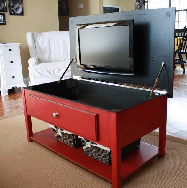 Small Apartment? Double your Coffee Table into a Tv Storage Cabinet, it's away when not in use, or quickly available at the lift of a door.