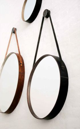 Captain's Mirror at BDDW: distressed leather frame lined with wood, machined bronze hanging puck