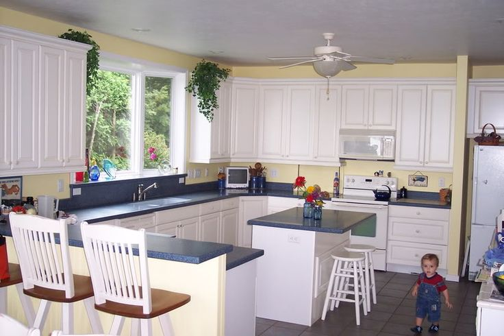 Pictures of kitchens with yellow walls white cabinets and for Yellow paint kitchen ideas