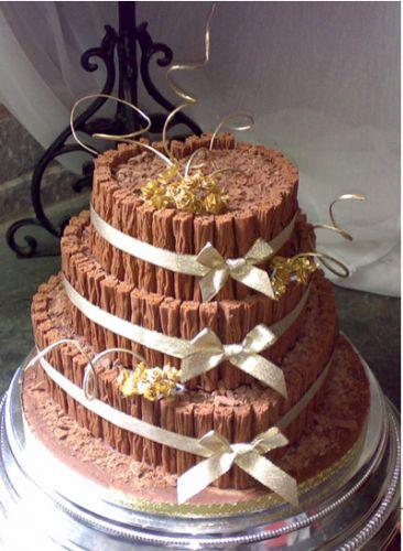 Flake coated heart-shaped chocolate wedding cake