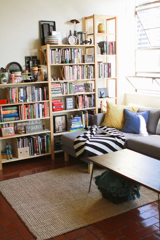 A Large Custom IKEA Bookshelf Is The Main Attraction Of Living Space And Showcases