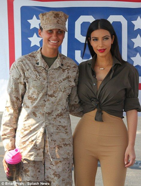 Weapon of mass distraction! Kim Kardashian looks booty-ful as she cheers up the U.S. troops onboard aircraft carrier in Dubai | Daily Mail Online