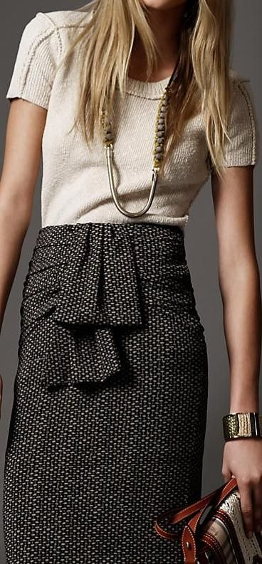 tweed pencil skirt, short sleeved knit top, chain necklace, oversized bracelet. Skirt from Burberry.