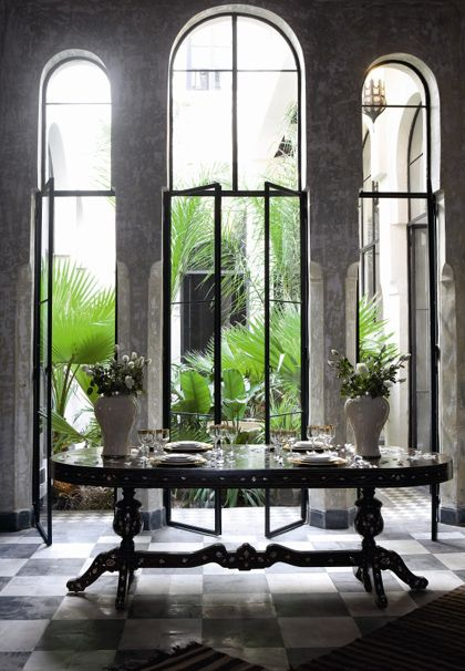 *moroccan black and white tile, black framed casements opening out to courtyard
